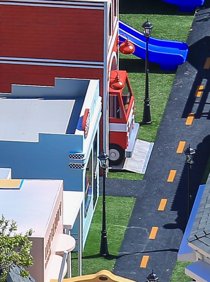 The front of a firetruck peeks out from the firehouse