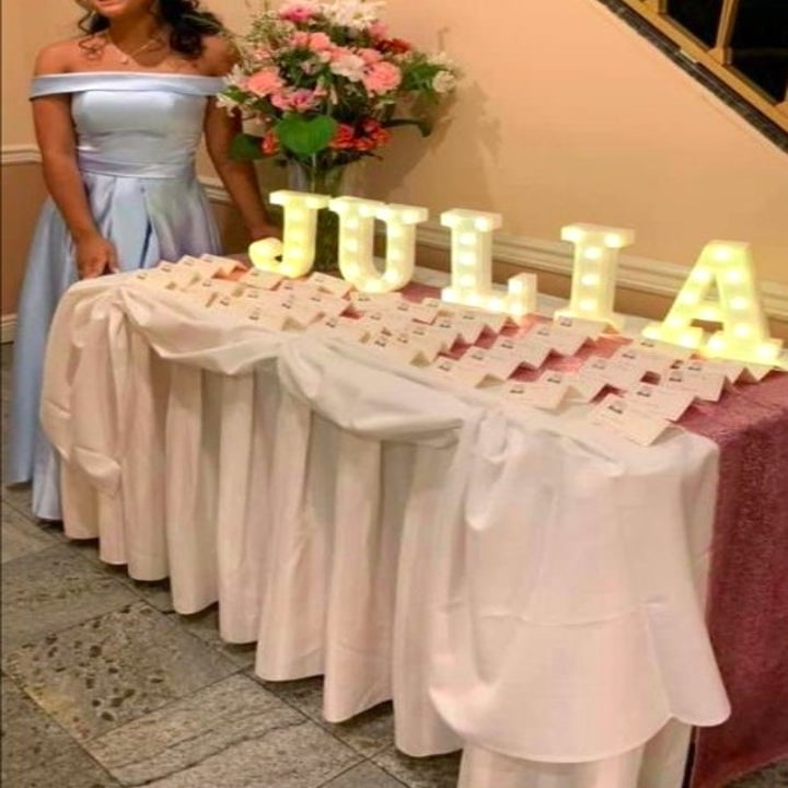 """light-up letters spelling the name """"Julia"""" on a table"""