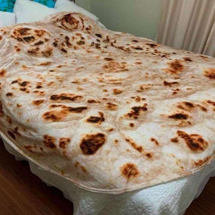 a tortilla blanket placed over a bed