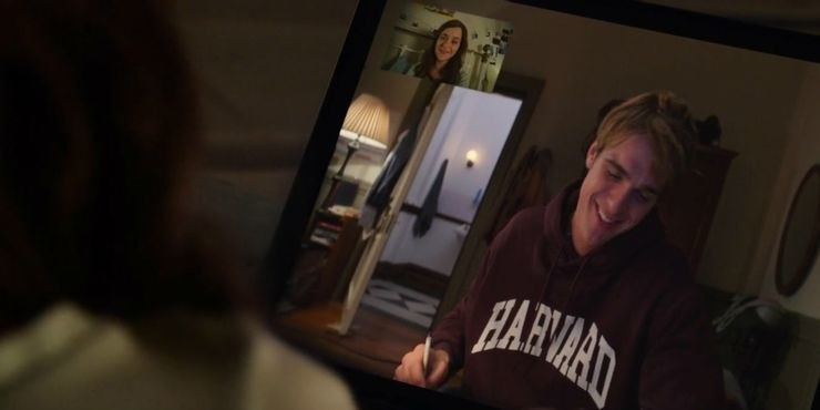 Elle FaceTiming Noah in his Harvard hoodie