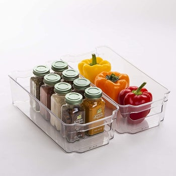 spices and bell peppers in smaller clear bins
