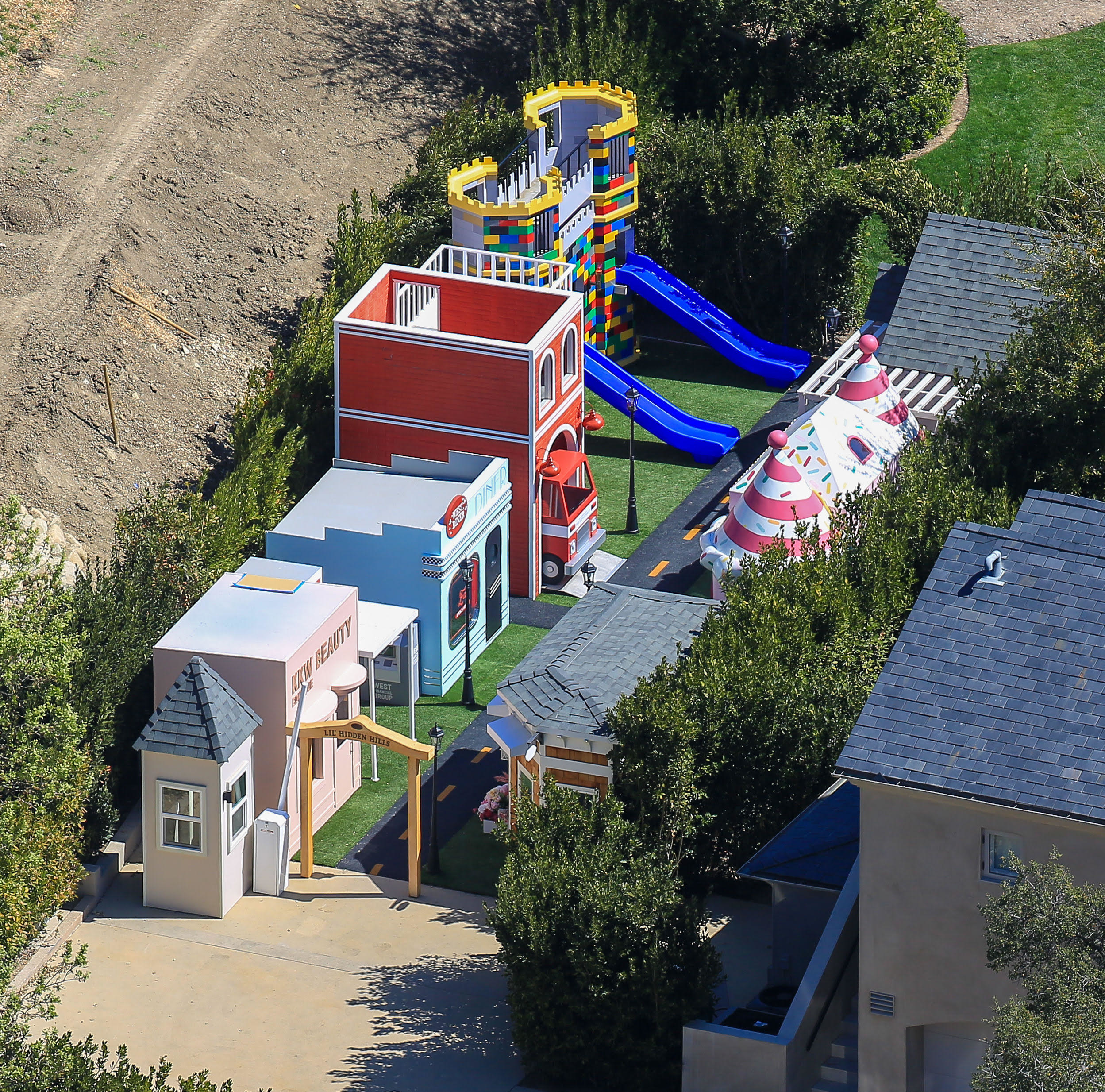 The multi-storied playhouse has two slides