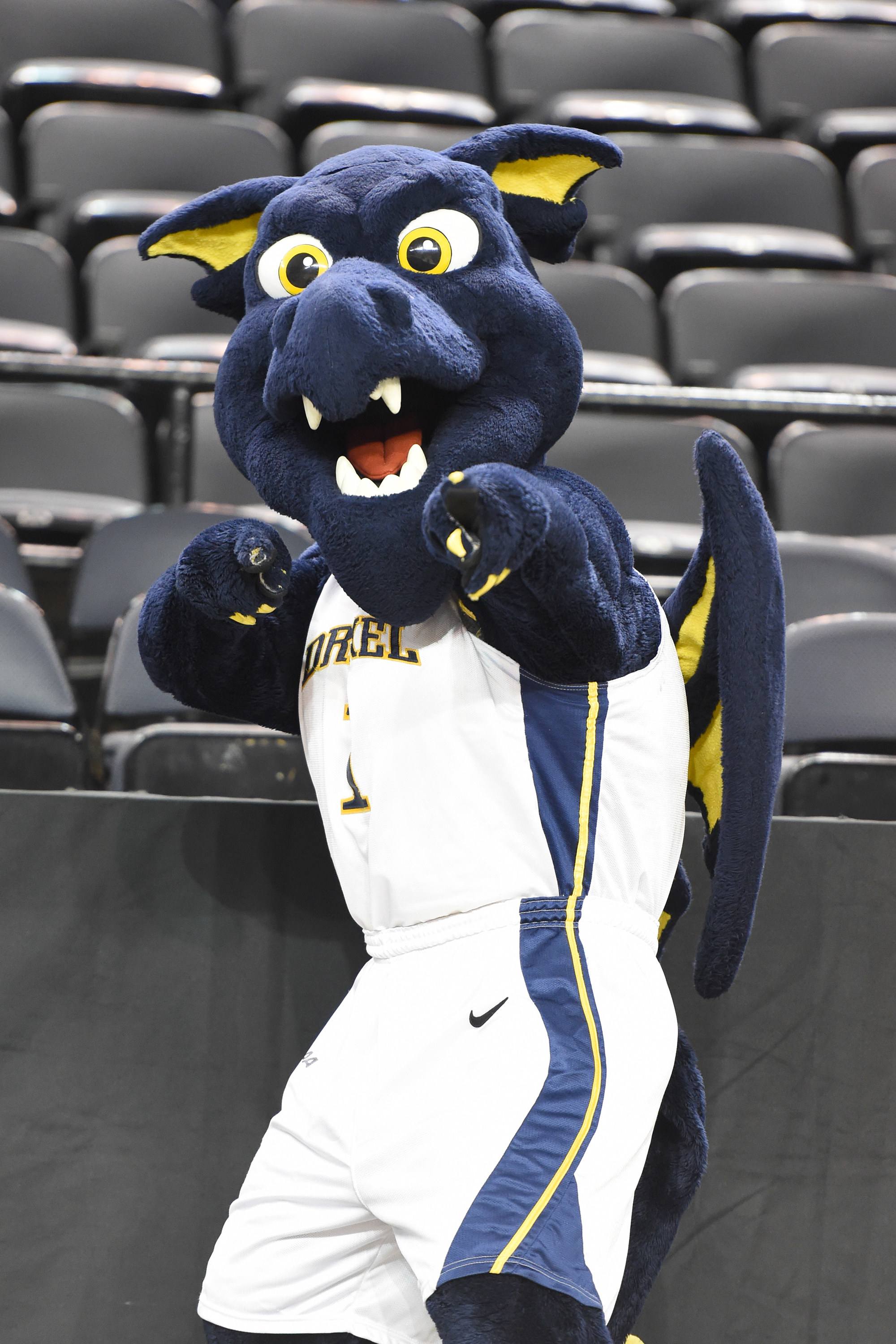 Blue Drexel mascot in a full jersey pointing at camera.