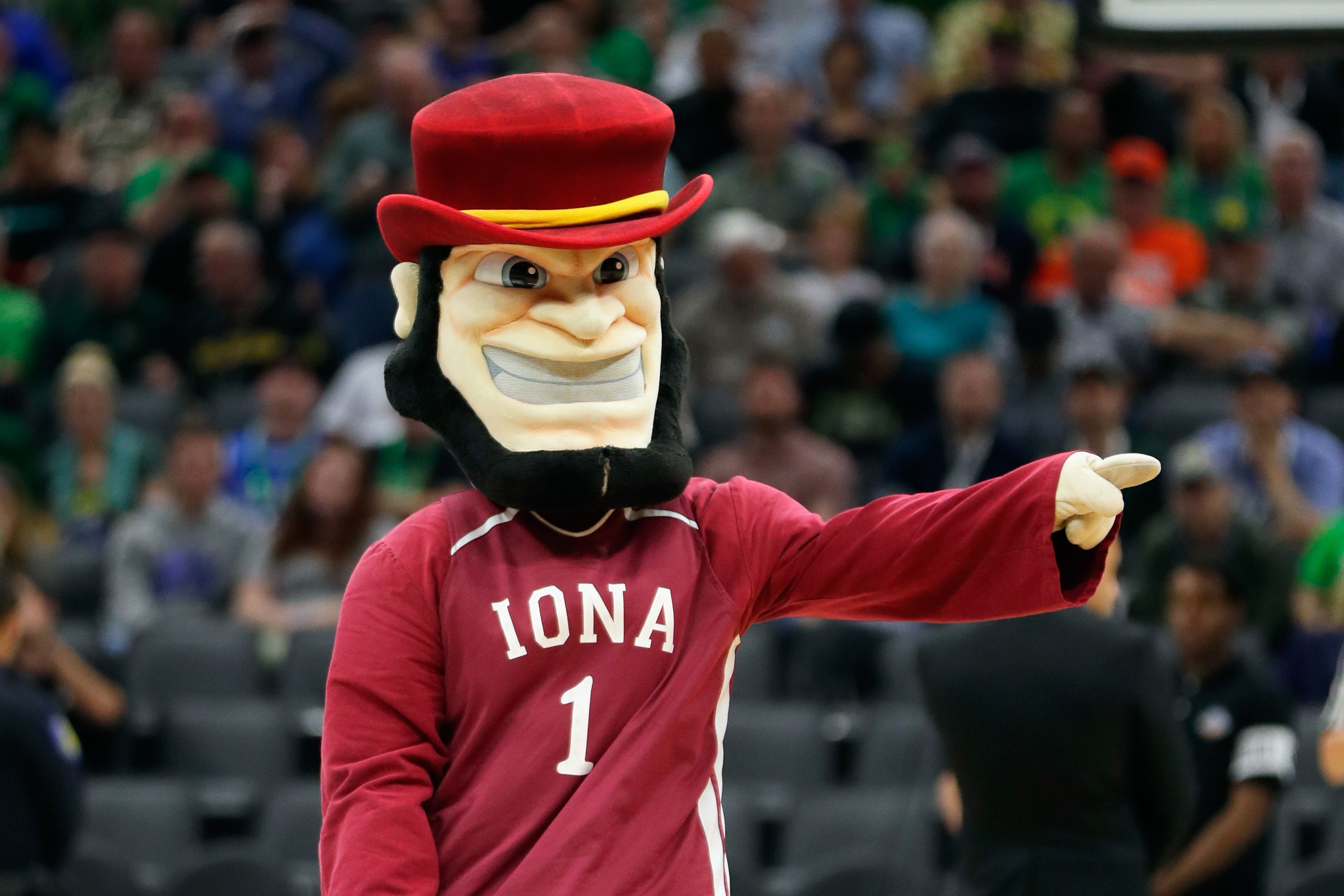 Iona Gaels mascot in red hat and jersey.