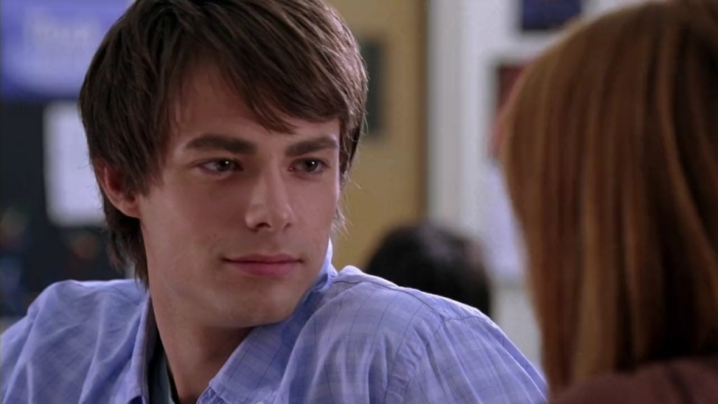Aaron Samuels spinning in his chair to talk to Cady
