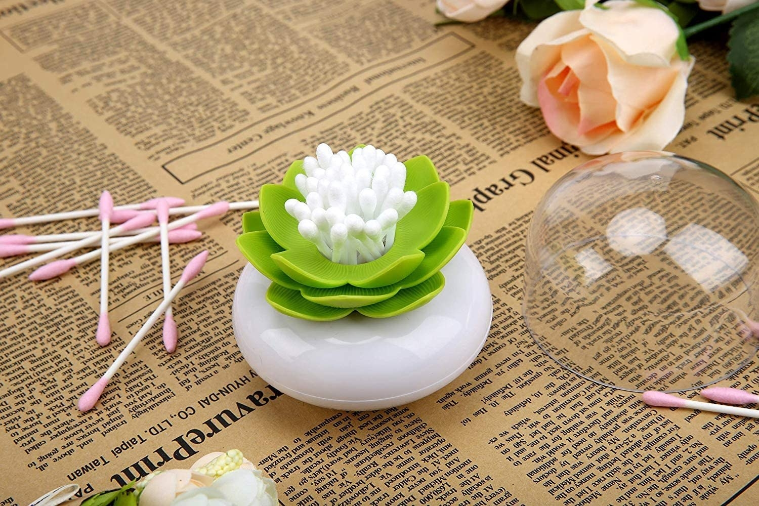 Flower-shaped cotton swab holder filled with cotton swabs