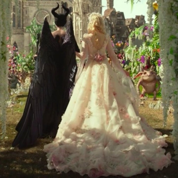 A shot of Aurora and Maleficent in wedding attire from behind