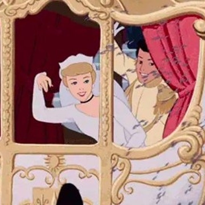 Cinderella wears a wedding dress and waves from a carraige