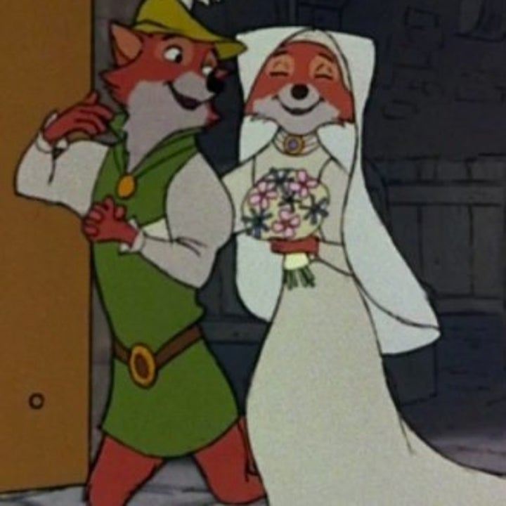 Marian and Robin, both cartoon foxes, exit a church in wedding clothes