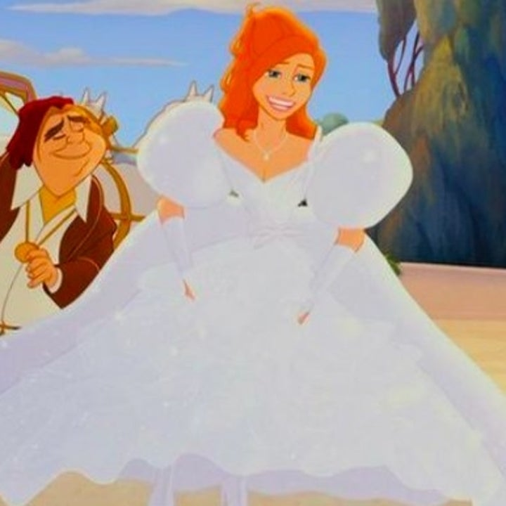 An animated Giselle holds up the bottom of her puffy dress while smiling