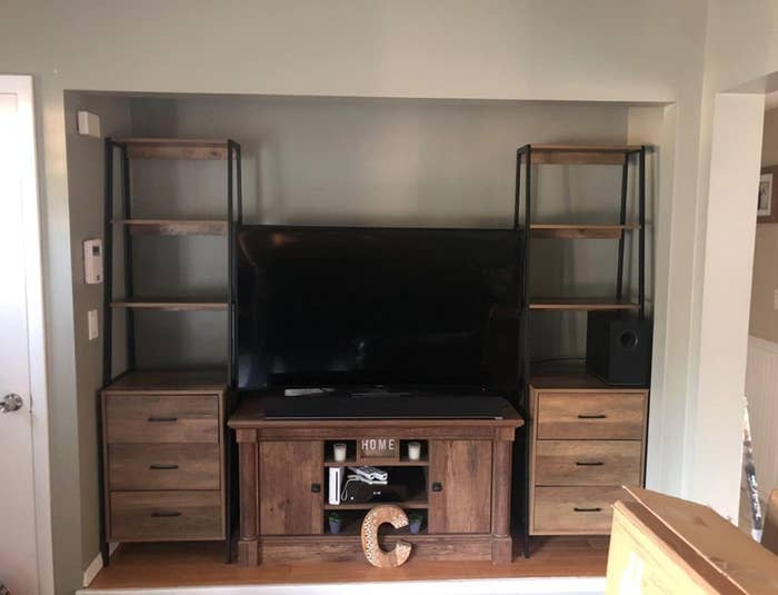 two of the tall bookshelves in a reviewer's home on either side of TV