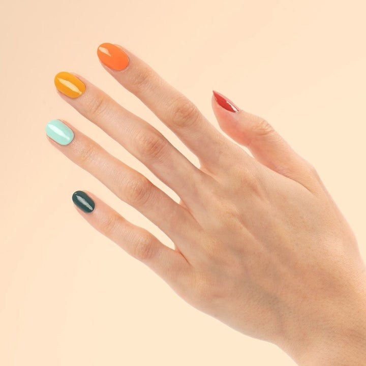 a hand with the nails painted using the colors from the spring nail polish set