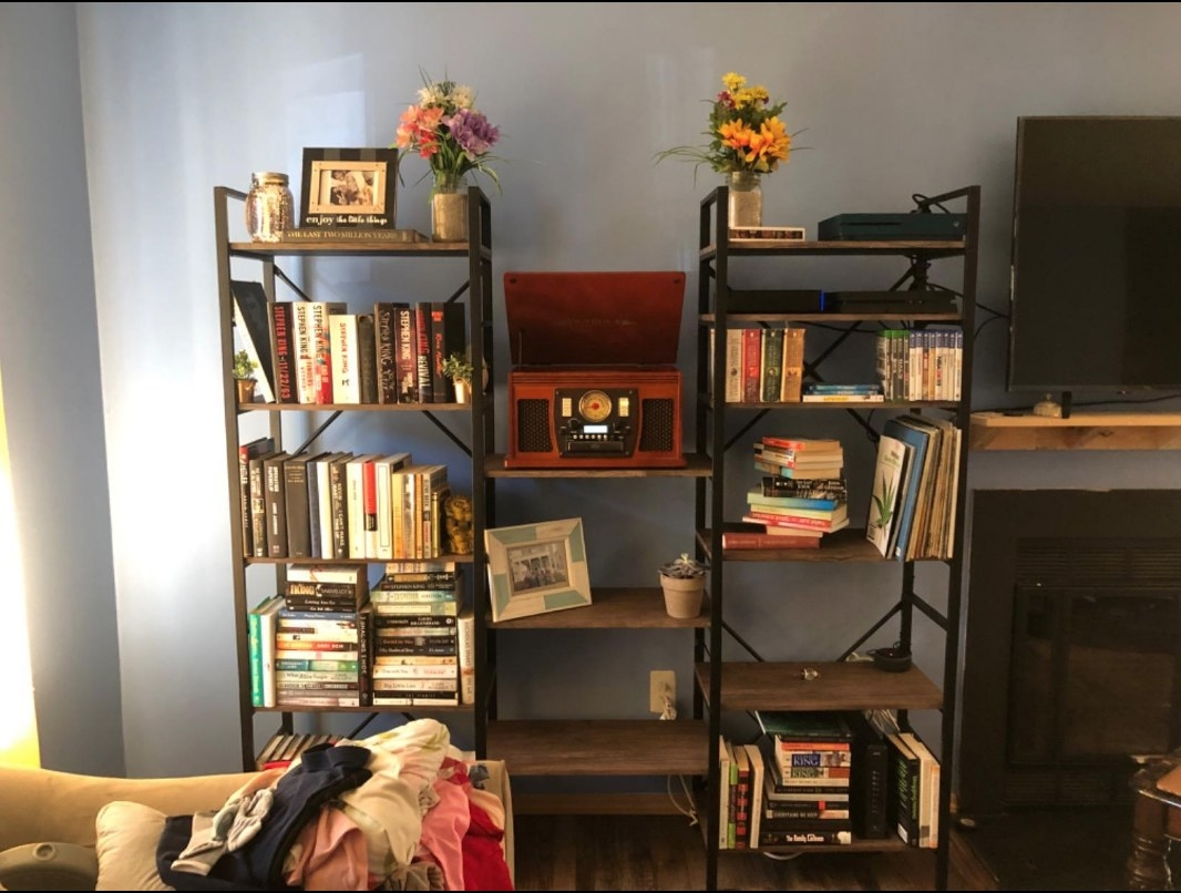 black and wood three-section bookcase in a reviewer's home