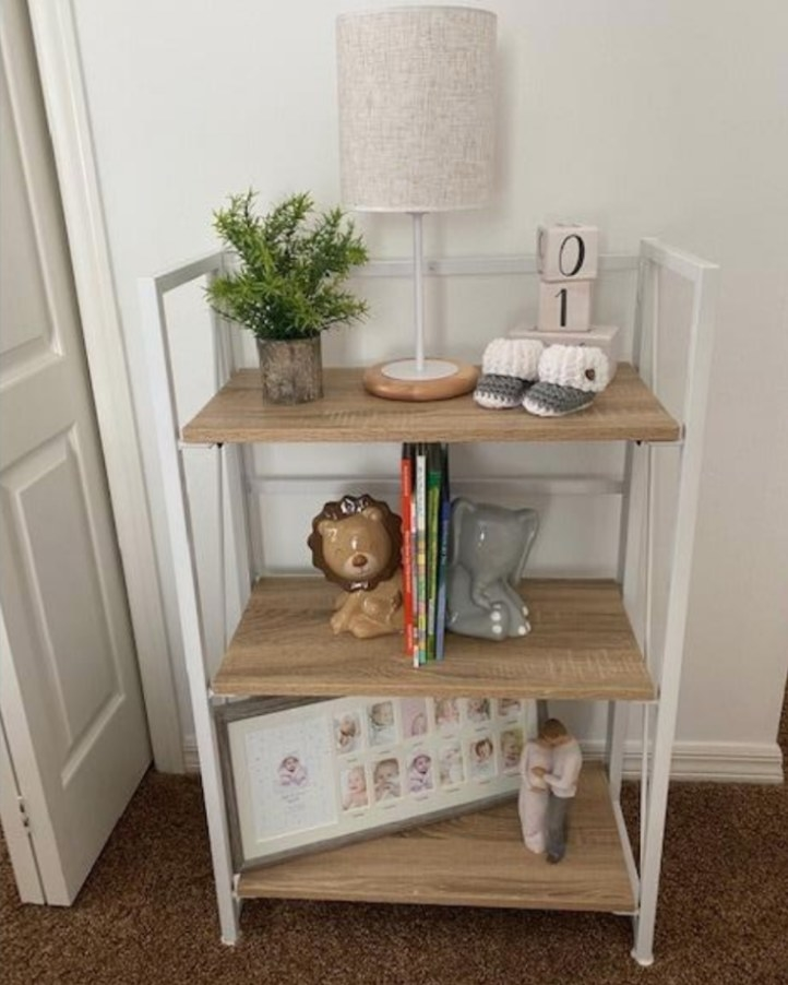 white and light wood bookcase in a reviewer's home
