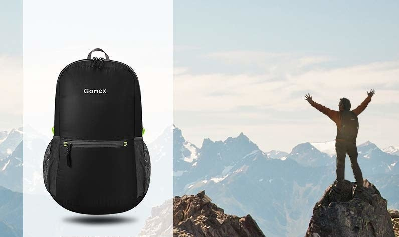 The lightweight backpack shown next to a person on a mountain