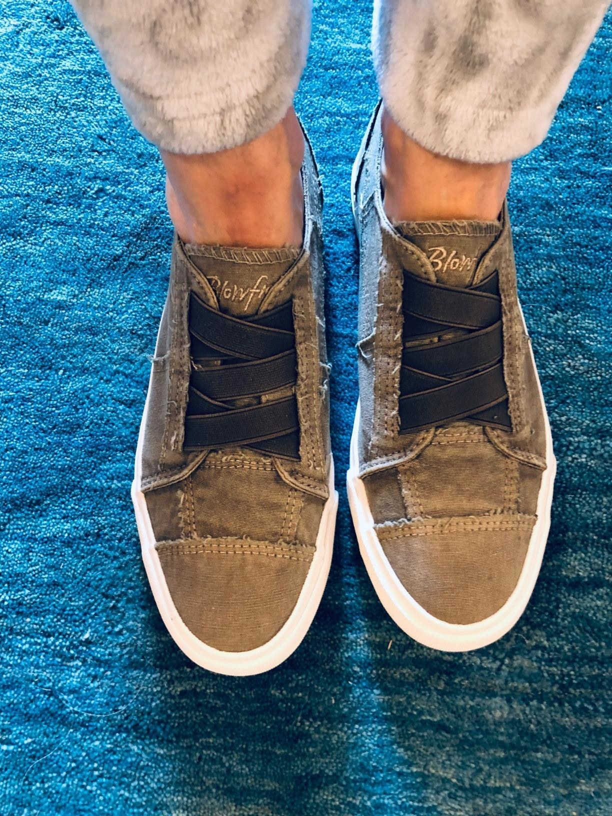 Reviewer wearing the steel gray color washed canvas sneakers