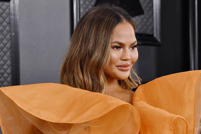 Chrissy Teigen on the red carpet at the Grammy Awards in 2020