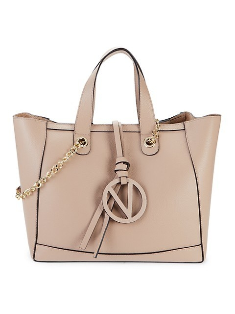 Tan leather bag with with two handles and gold hardware