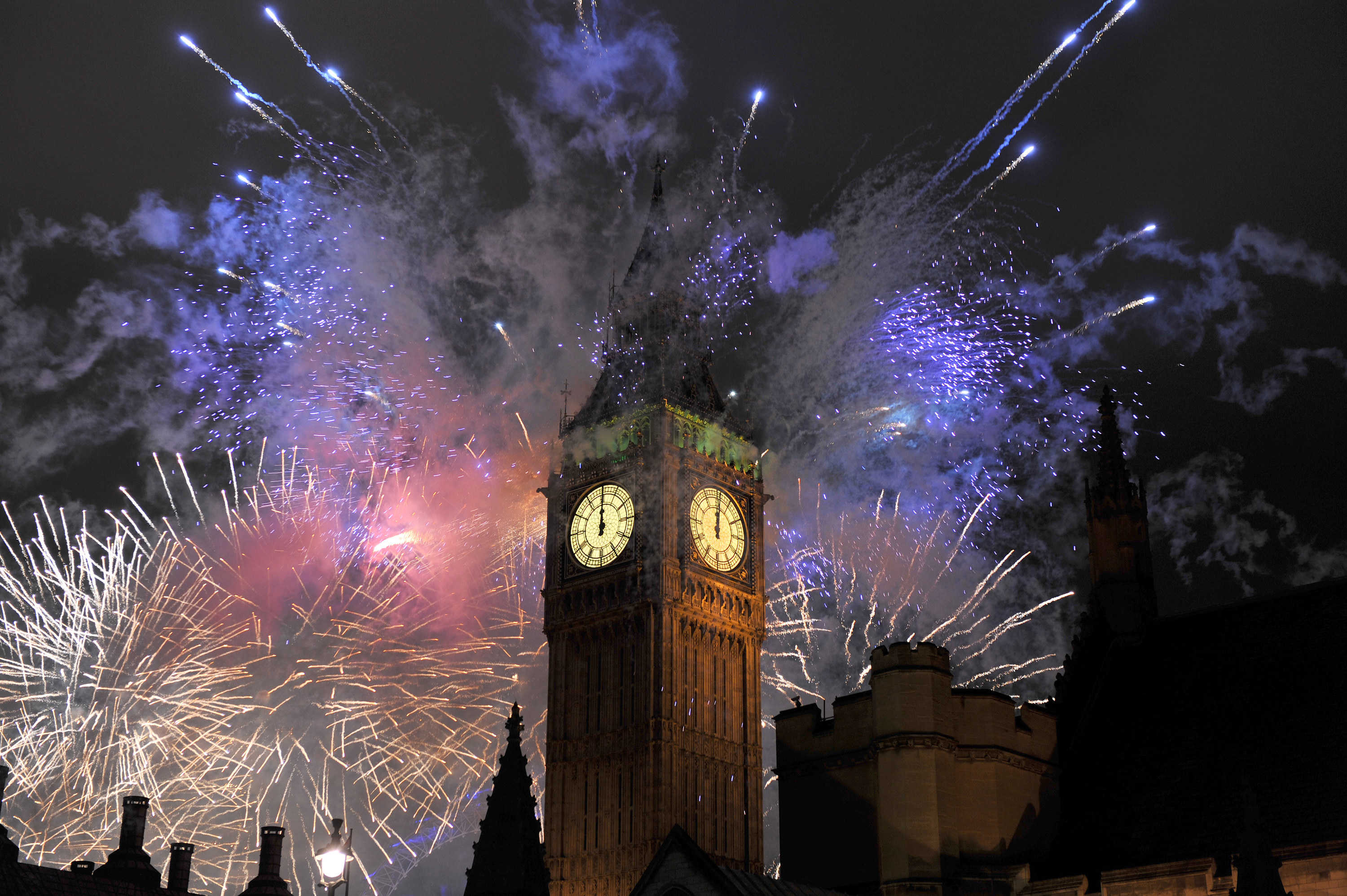 Fireworks going off behind Big Ben for Guy Fawkes Day
