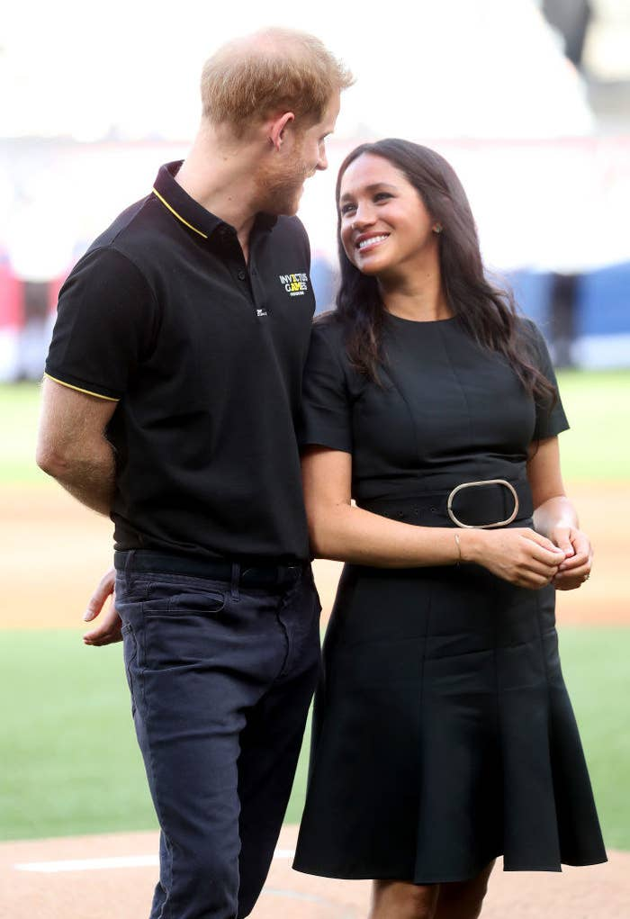 Prince Harry (L) and Meghan, Duchess of Sussex prepare to watch the first pitch as they attend the match between the Boston Red Sox and the New York Yankees