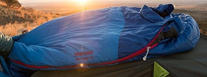 The sleeping bag in the light of a rising sun