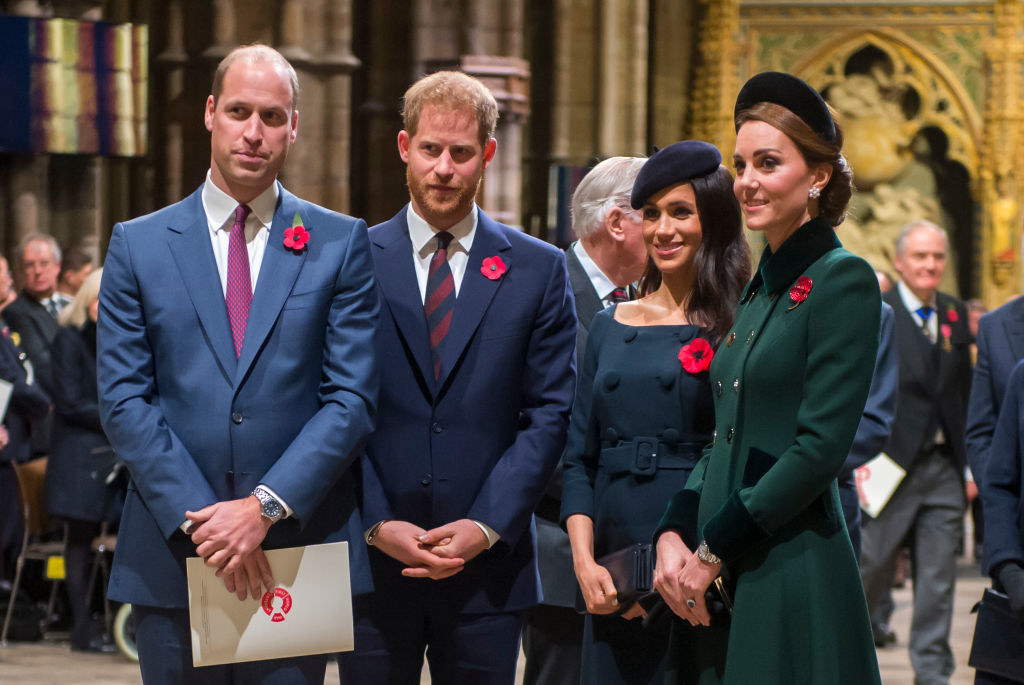 (L to R) Prince William, Prince Harry, Meghan Markle, and Kate Middleton attend a service marking the centenary of the WW1 Armistice