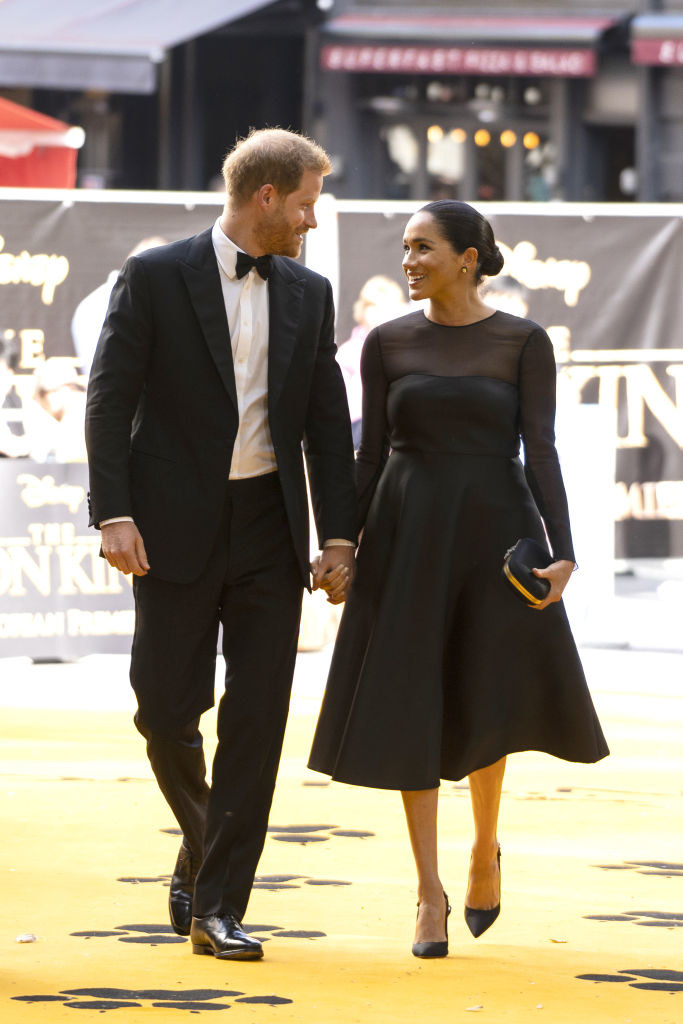 """Prince Harry (L) and Meghan smile at each arrive at the European premiere of Disney's """"The Lion King"""""""