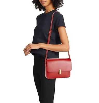 Red boxy leather shoulder bag with gold hardware