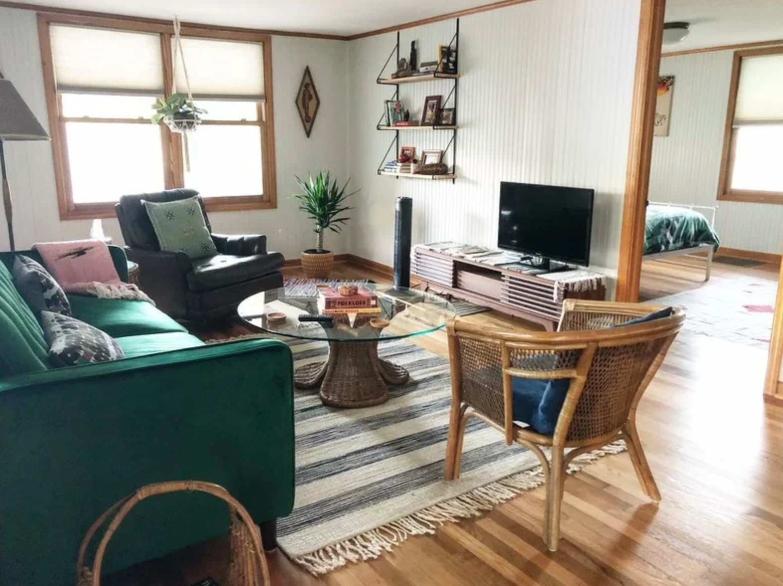 The TV stand holding a flat screen in a boho living room