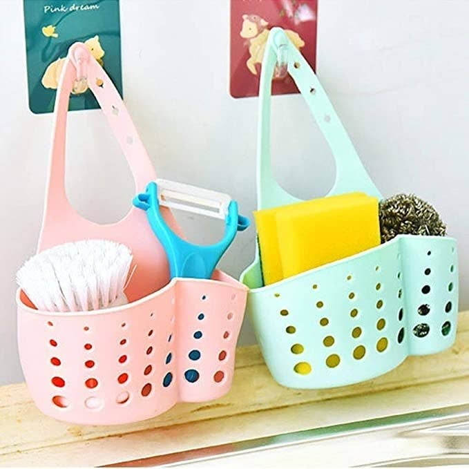 Sink caddy with cleaning brushes in it.