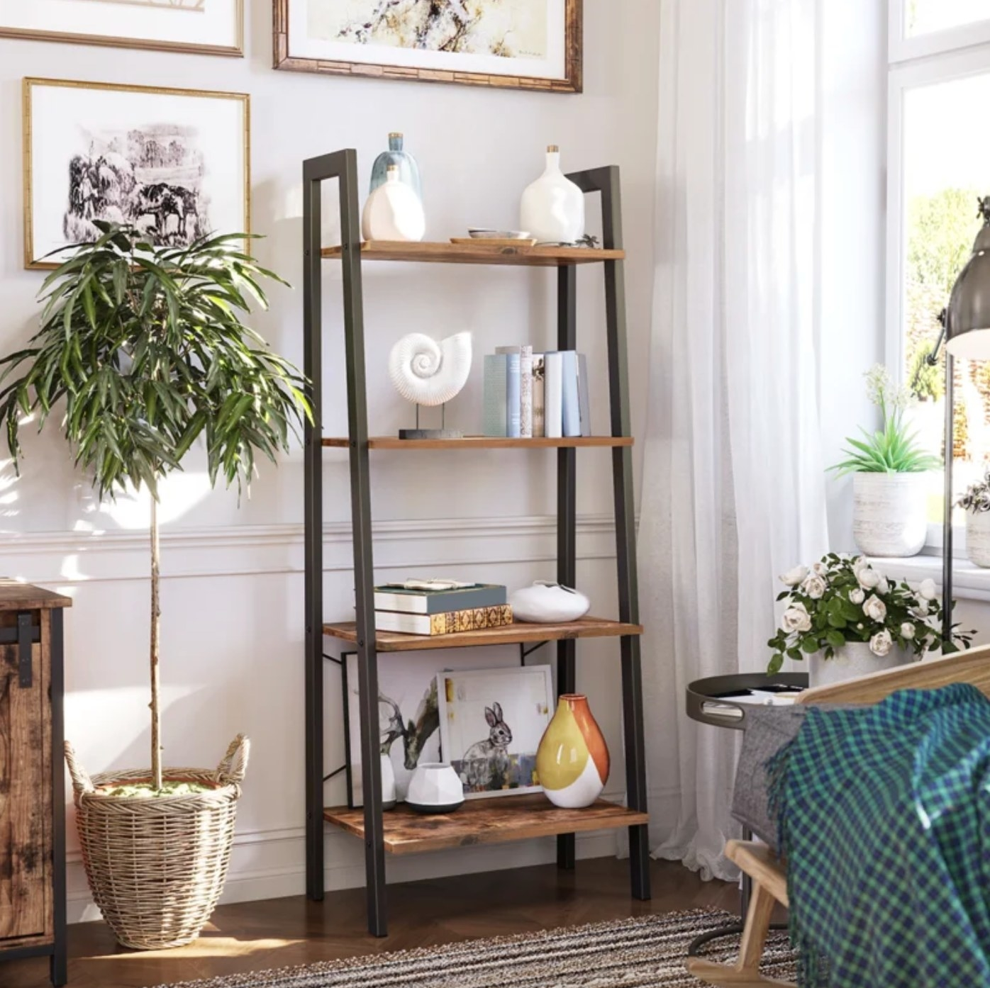 The steel bookcase covered in books, vases, and trinkets