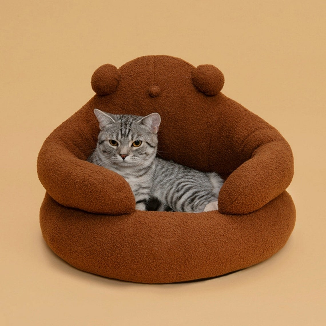 Round plush cat bed designed to look like pet is being hugged by a round, soft critter when they lie inside