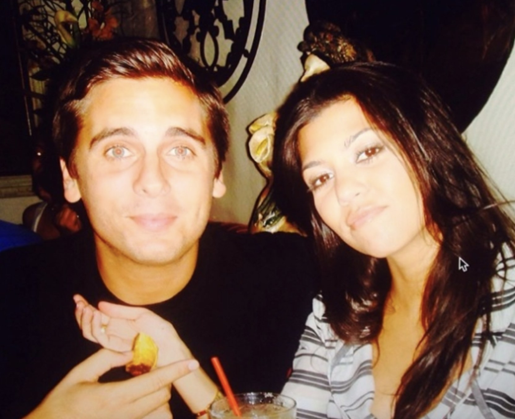 A very young Scott and Kourtney looking into the camera