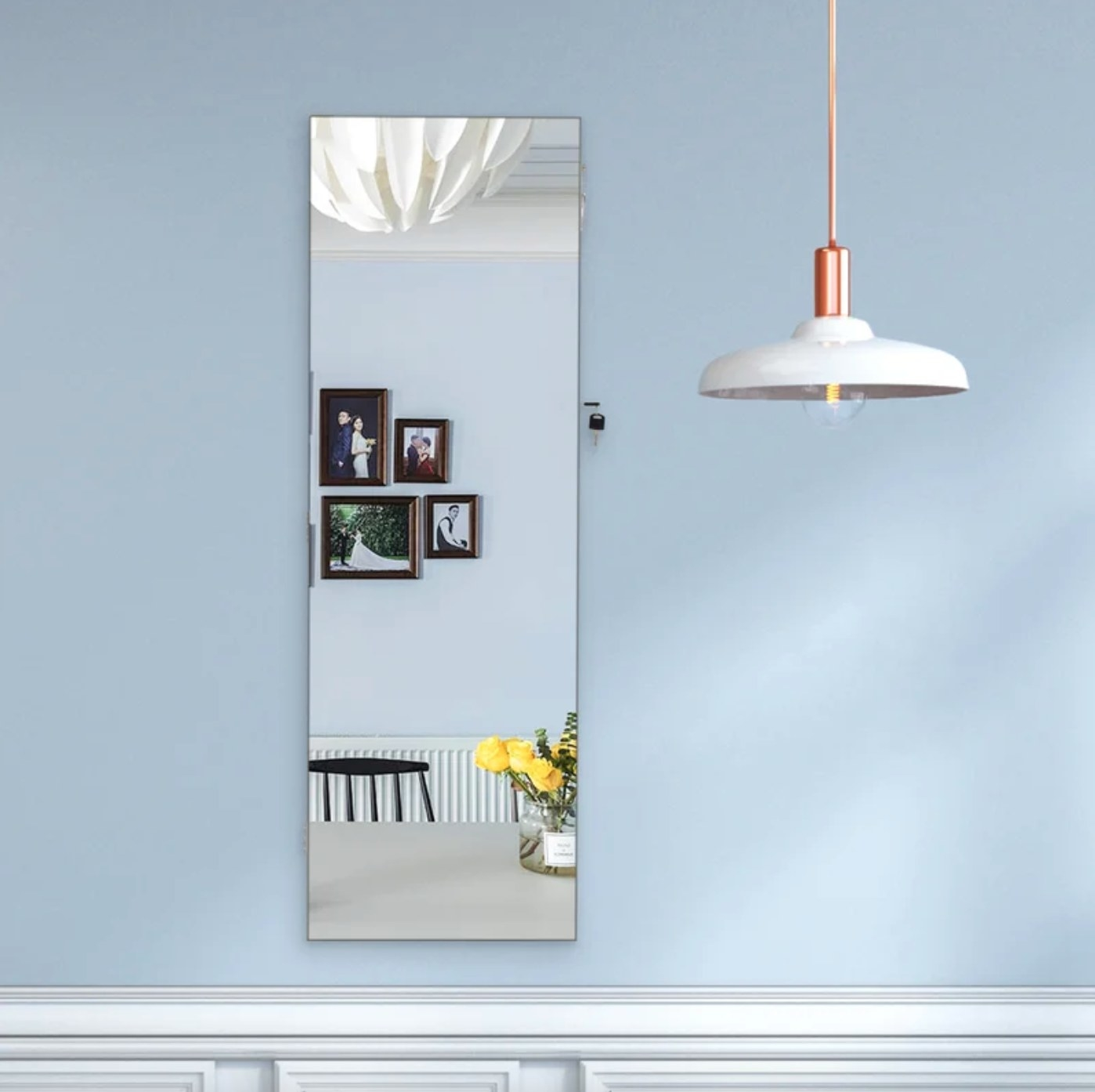 The mounted jewelry armoire that looks like a frameless mirror