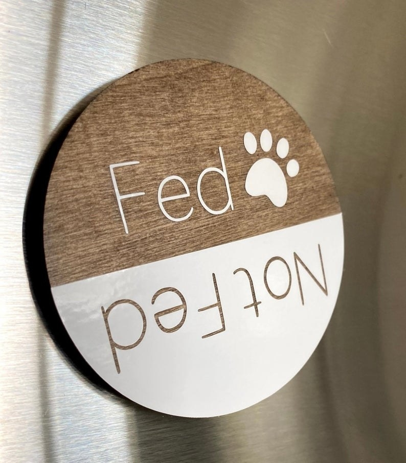 "Round magnet. One end says ""Fed"" and the other says ""Not Fed."""