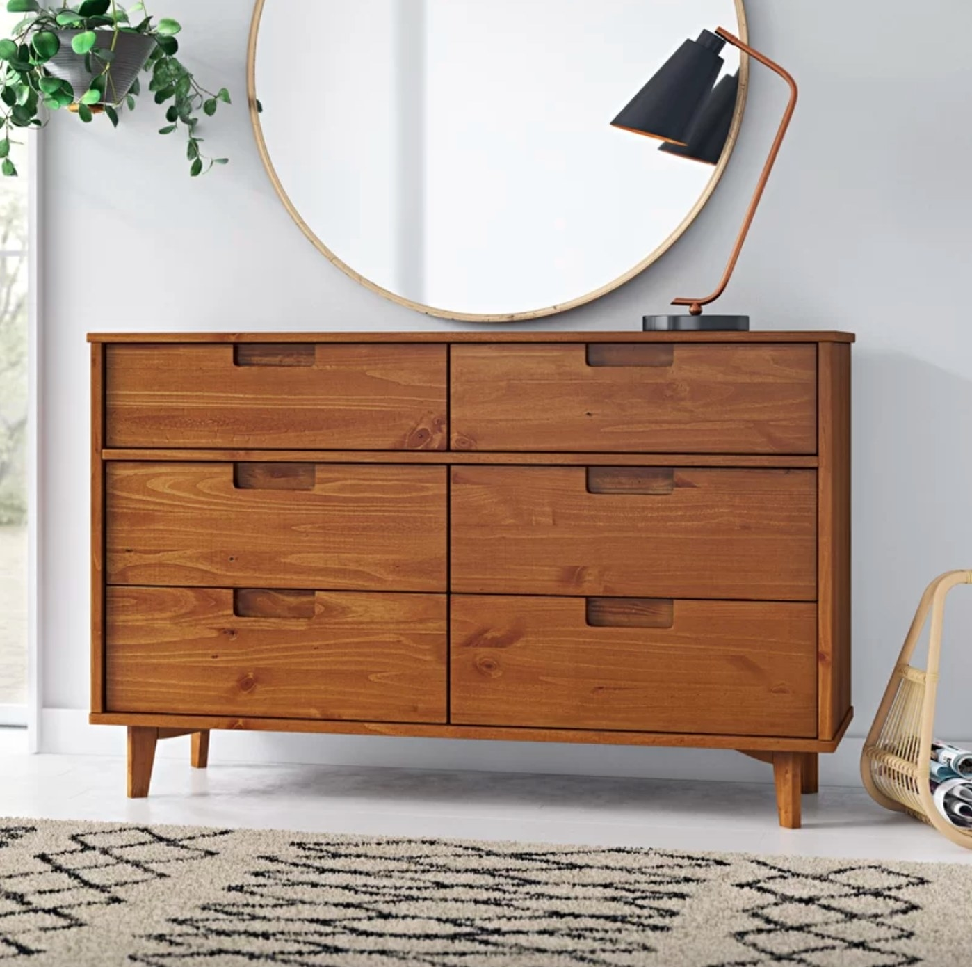 The six drawer double dresser in caramel holding a lamp