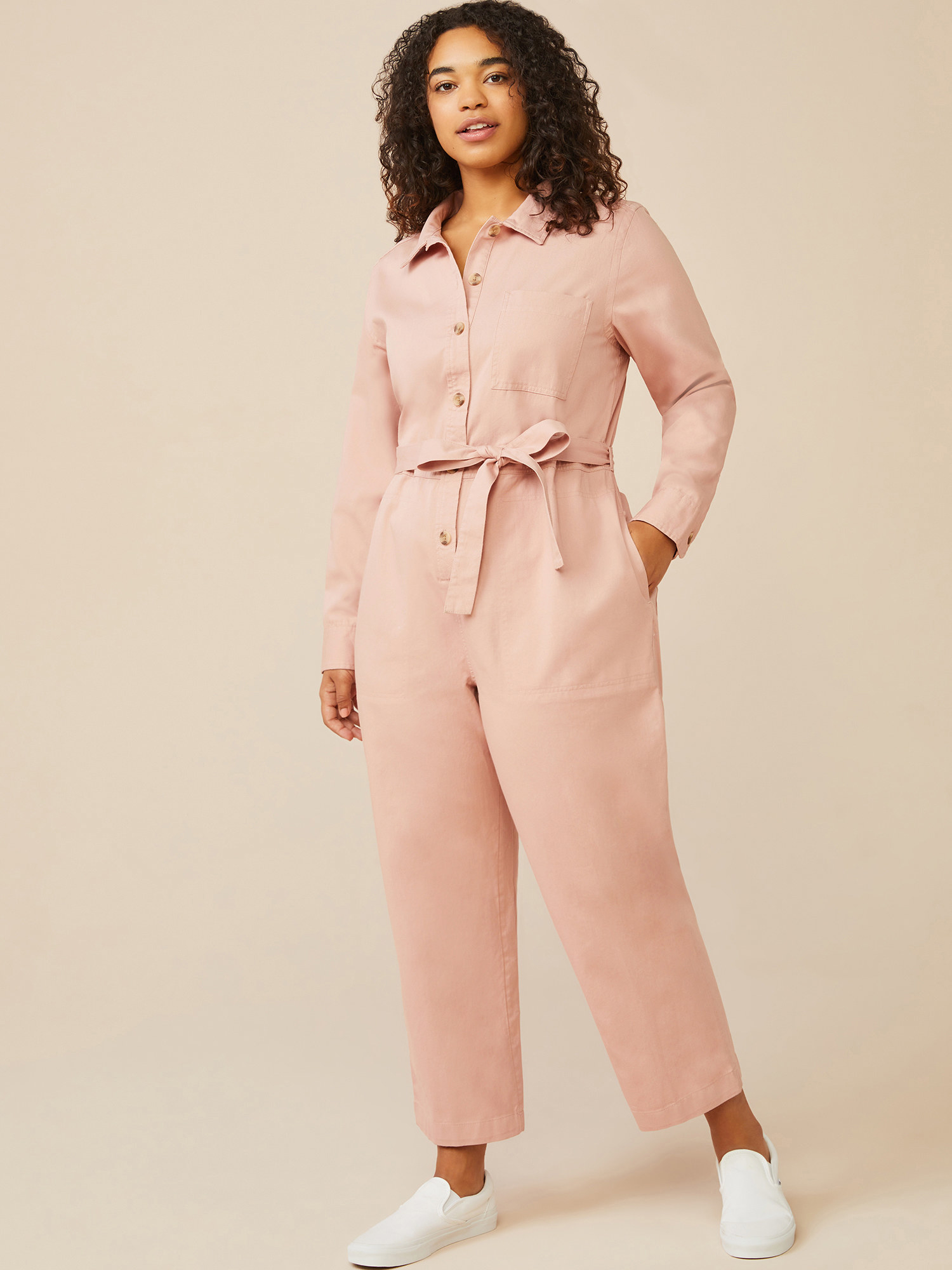 model wearing the pastel pink coverall