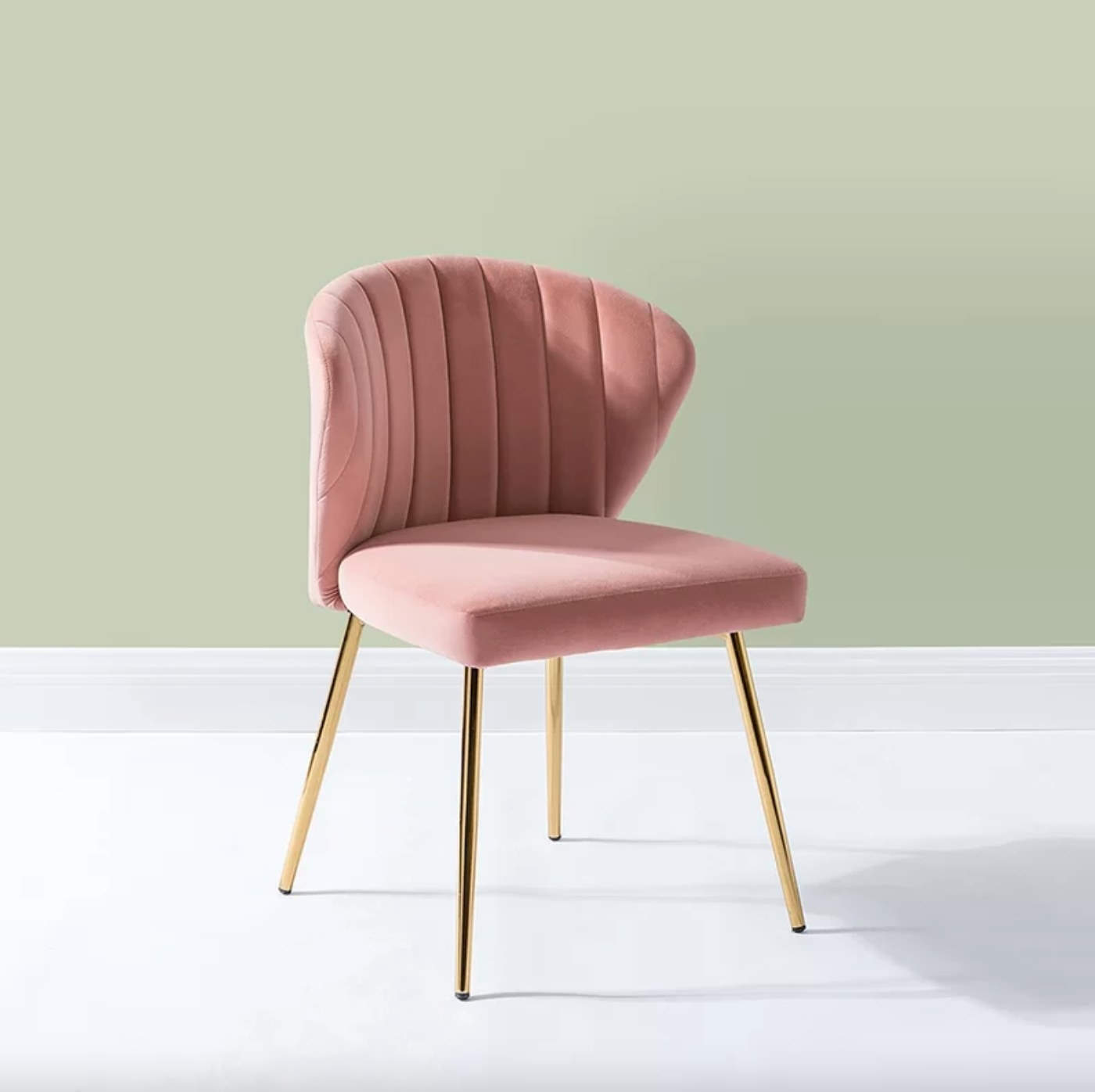 The velvet side chair in pink with bronze legs
