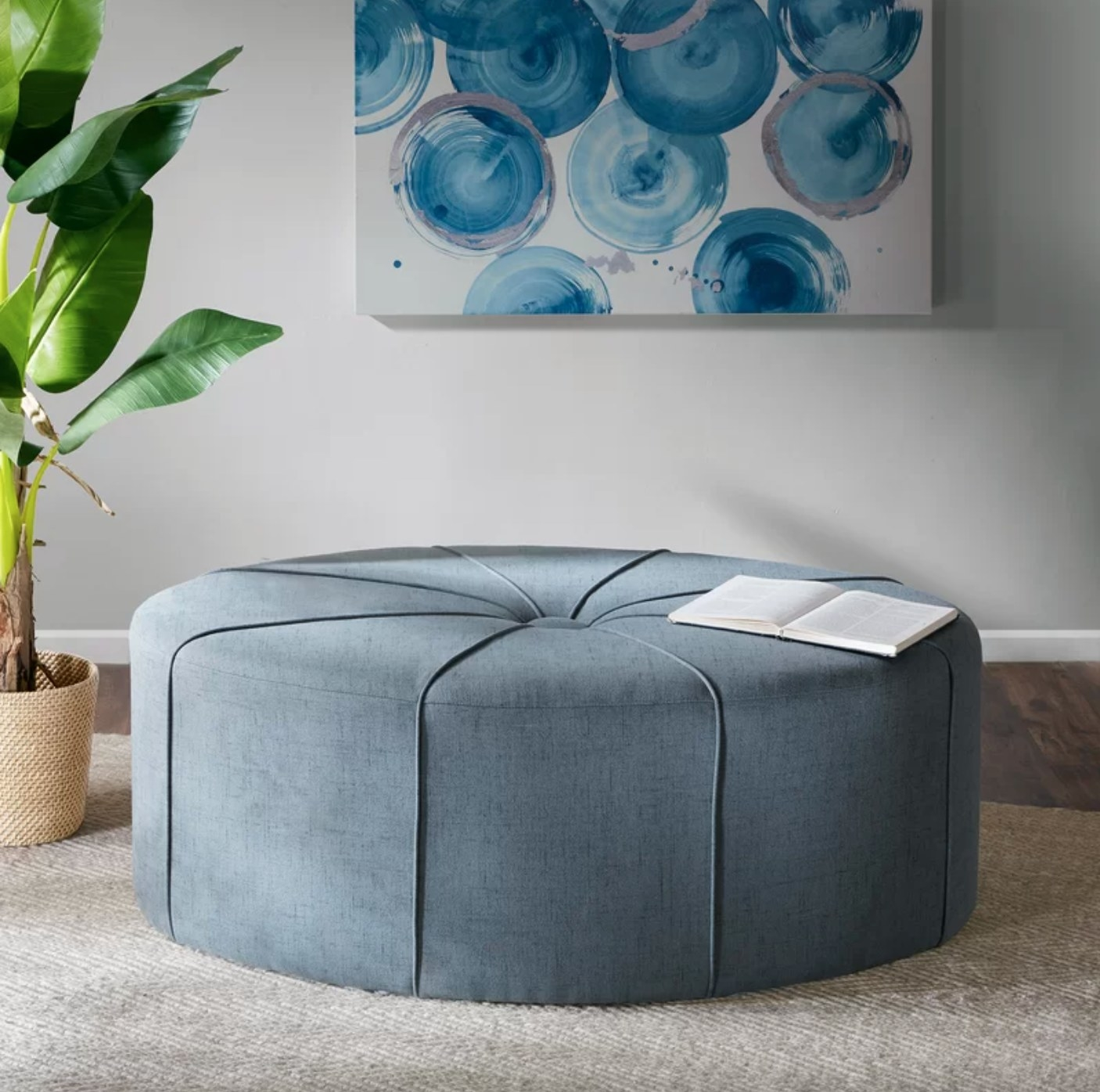 The large oval ottoman in blue polyester blend