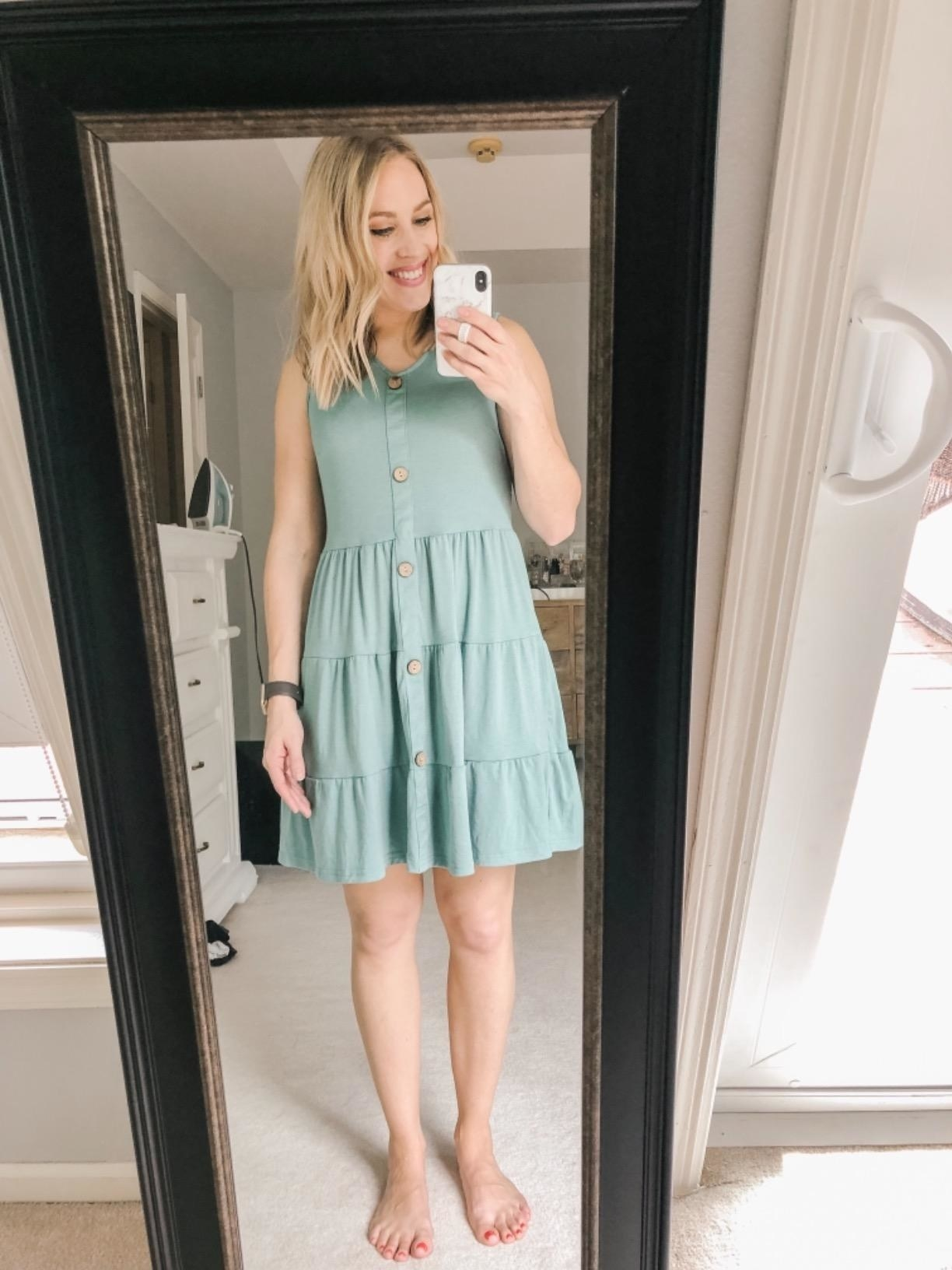 reviewer mirror selfie; they're wearing the light green Mitilly sleeveless v-neck button down dress