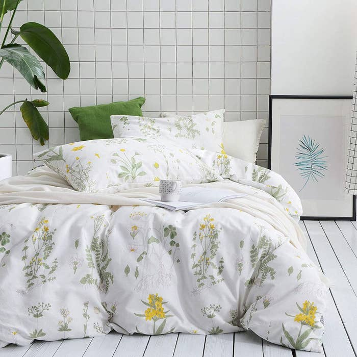 The white sheets with yellow and green botanical pattern