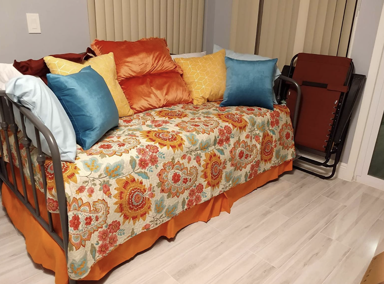 A reviewer's daybed with an orange bed skirt