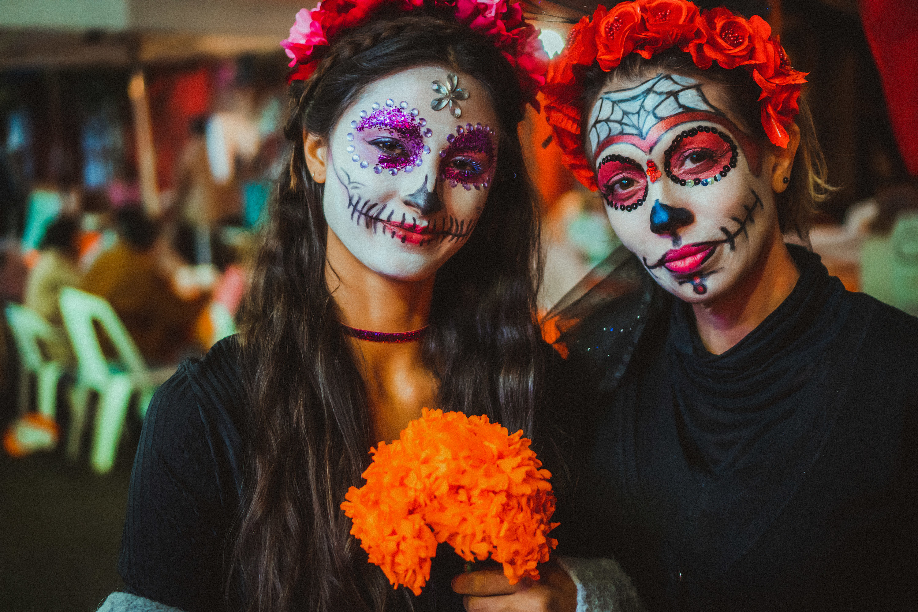 A mother and daughter wearing tradition skull face paint for Day of the Dead
