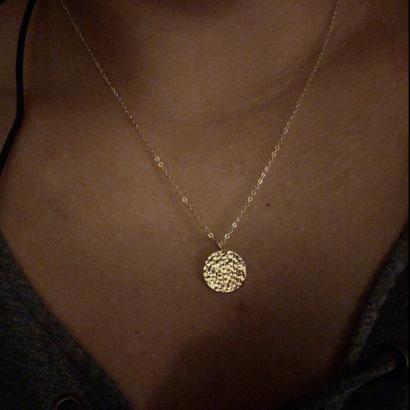 Reviewer wearing the necklace