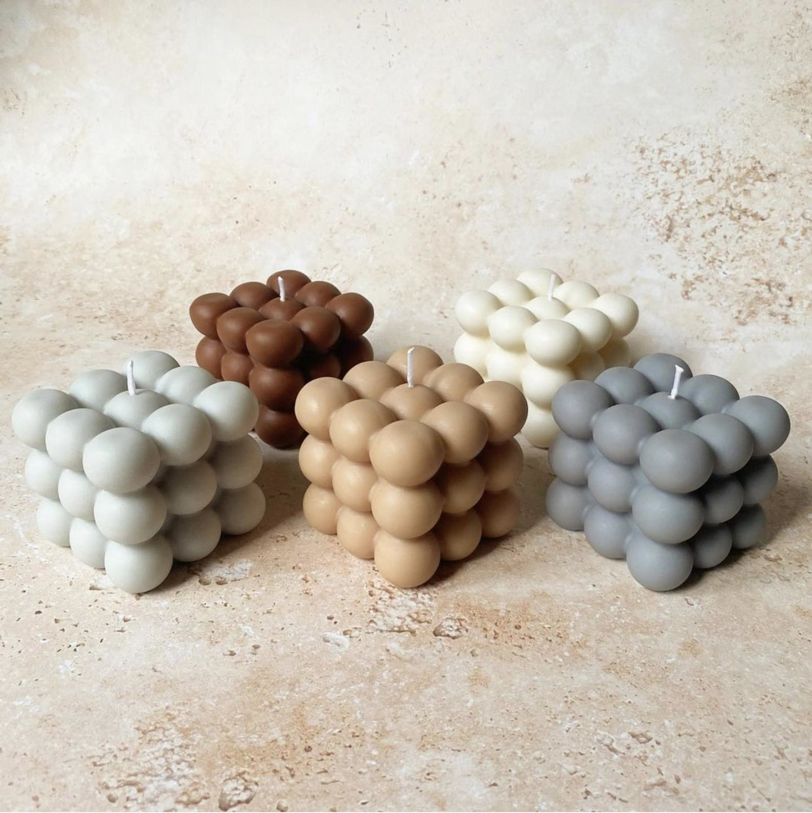 five bubble candles on a textured surface