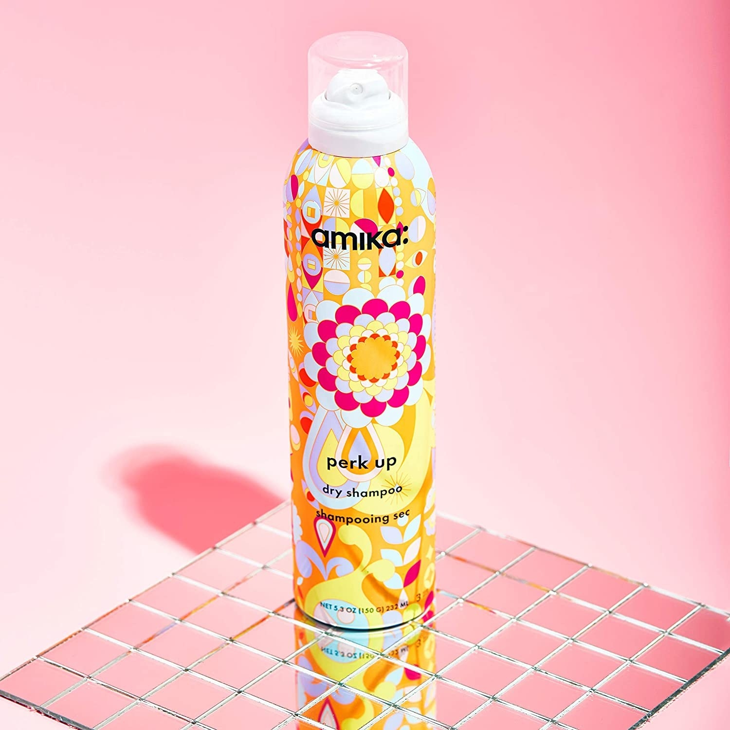 the yellow bottle of dry shampoo