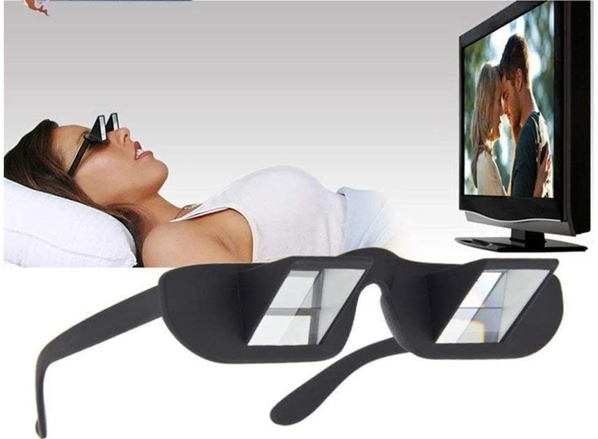 person lying down watching TV