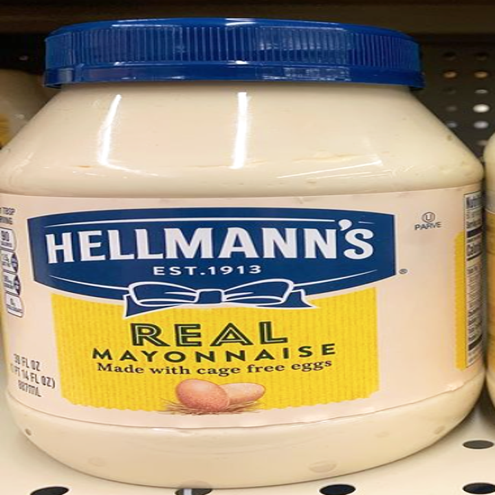 """A jar of Hellmann's mayo with blue and yellow coloring, a blue bow and """"real mayonnaise"""" written on it"""
