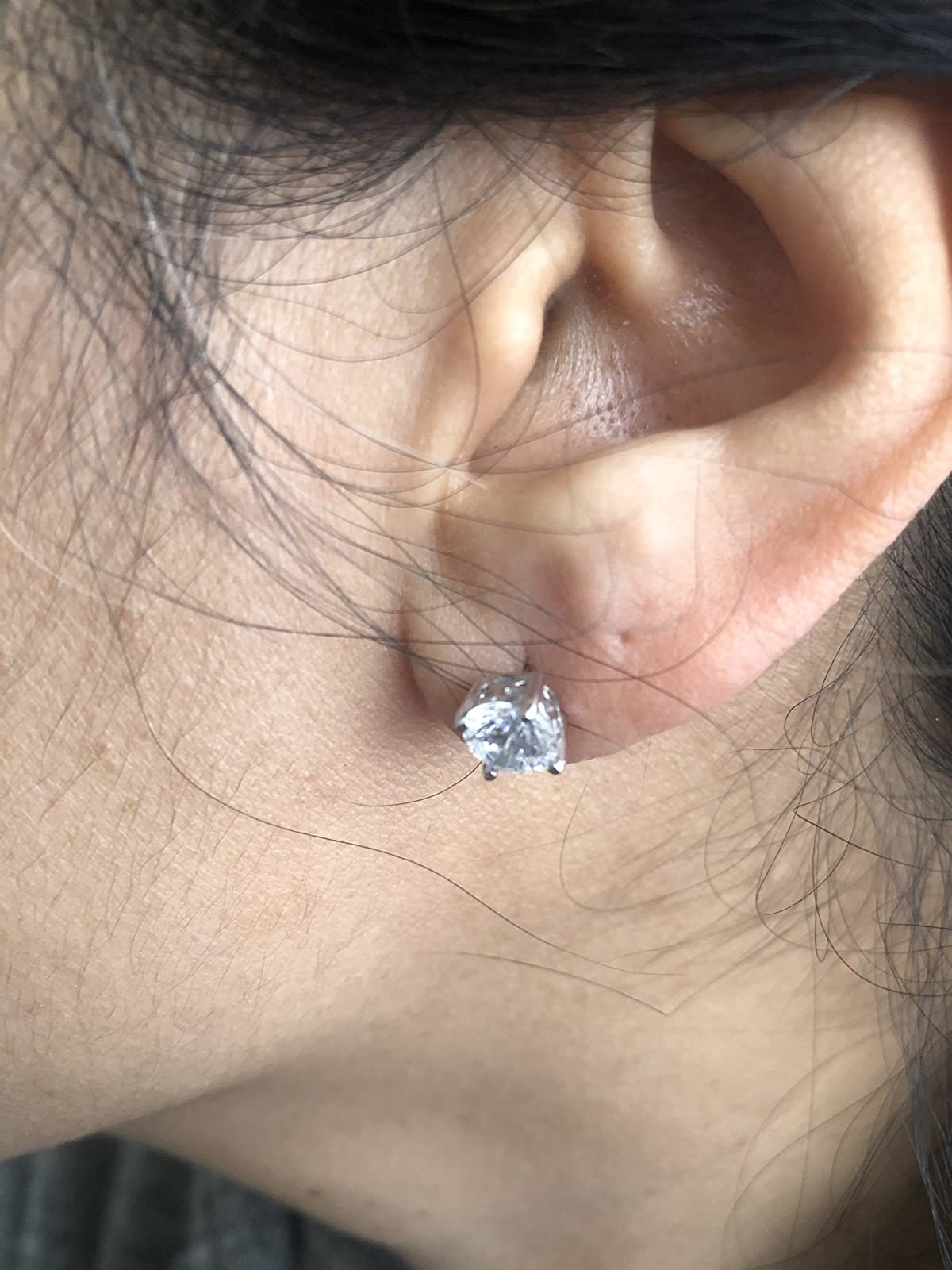 Reviewer wearing the platinum-plated earrings