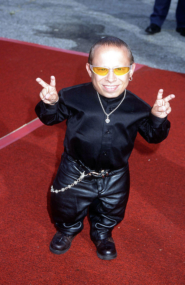 verne in leather pants and baby sunglasses
